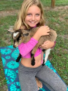 Goat Yoga with baby goats is thoroughly enjoyed by kids.